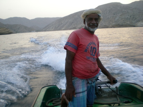 Abdullah steering boat