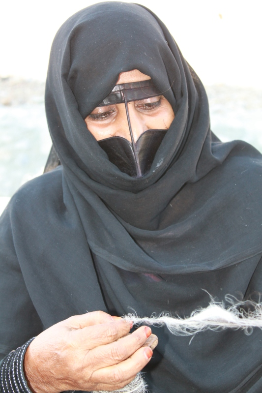 Omani lady selling crafts