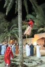 Omani man from Suwaiq demonstrates how they collect dates at the Muscat Festival