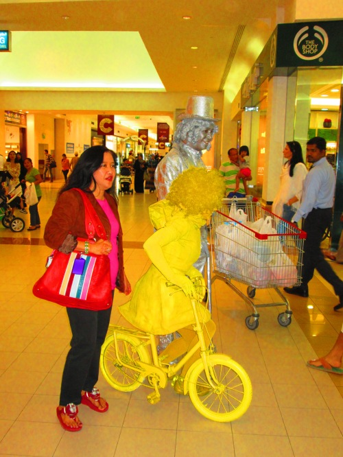 yellow bike silver man